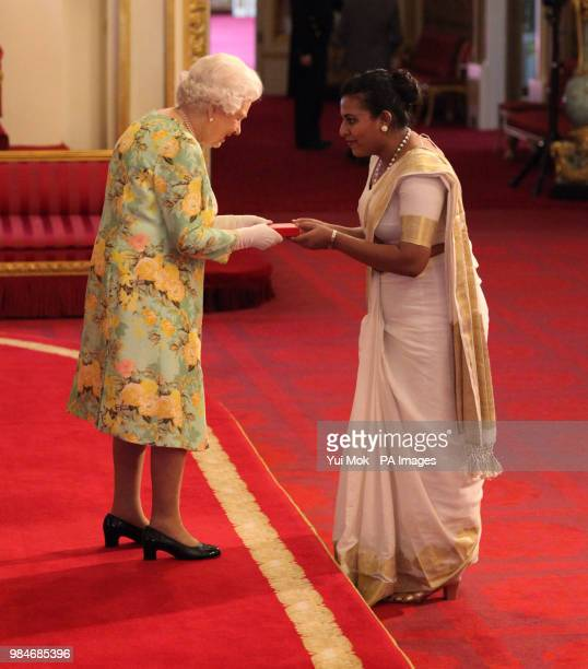 Ms Bhagya Wijayawardane from Sri Lanka receives her Young Leaders Award from Queen Elizabeth II during a ceremony in the Ballroom at Buckingham Palace