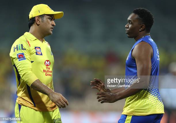 Ms Dhoni of the Chennai Super Kings speaks with Dwayne Bravo during the India Premier League IPL Qualifier Final match between the Mumbai Indians and...
