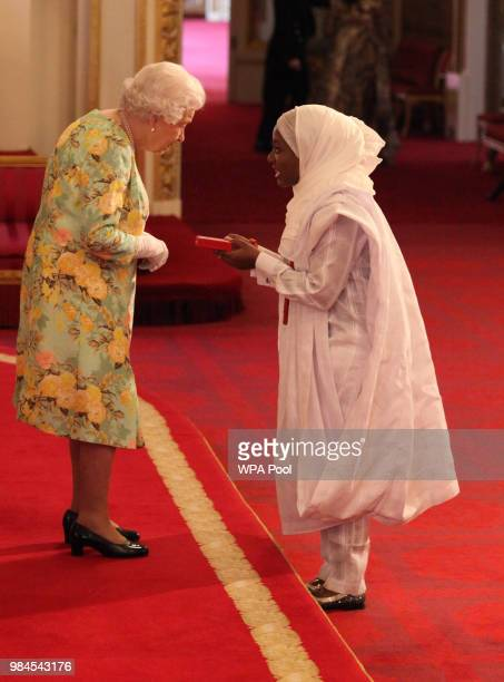 Ms Hauwa Ojeifo from Nigeria receives her Young Leaders Award from Queen Elizabeth II during the Queen's Young Leaders Awards Ceremony at Buckingham...