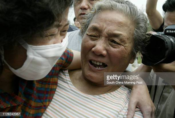 Ms Hong Yu who is a former SARS patient breaks down as she greets a relative upon her release from the Xiaotangshan SARS hospital in the north of...