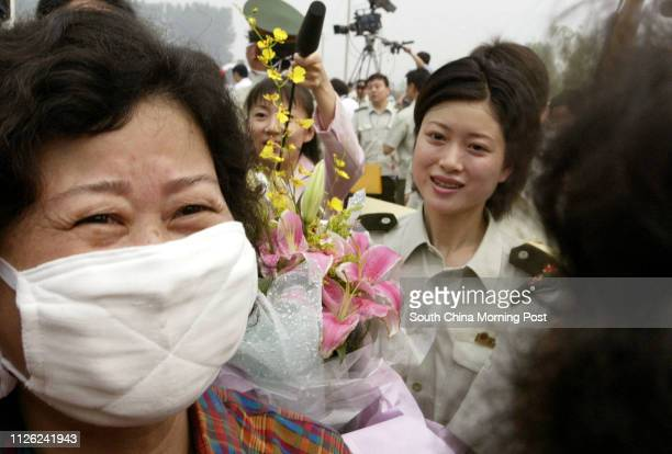 Ms Hong Yu who is a former SARS patient breaks down as she sees a relative upon her release from the Xiaotangshan SARS hospital in the north of...