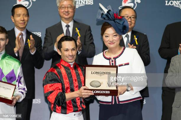 Ms Karen Au Yeung, Vice President of LONGINES Hong Kong, presents a LONGINES Conquest Classic Collection watch to Silvestre de Sousa, winner of the...