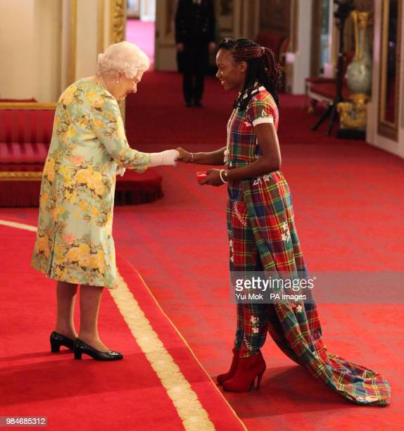 Ms Lakeyia Joseph from Dominica receives her Young Leaders Award from Queen Elizabeth II during a ceremony in the Ballroom at Buckingham Palace