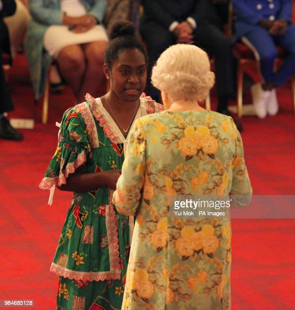 Ms Litiana Kalsrap from Vanuatu receives her Young Leaders Award from Queen Elizabeth II during a ceremony in the Ballroom at Buckingham Palace