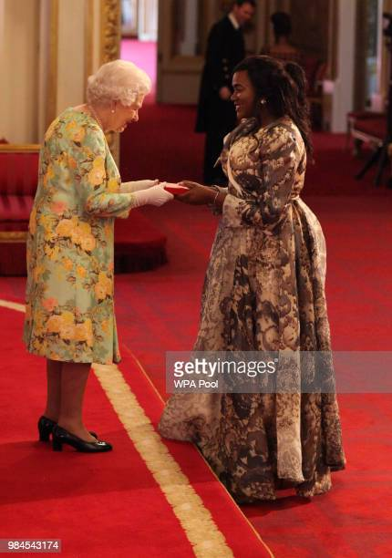 Ms Mavis Elias from Namibia receives her Young Leaders Award from Queen Elizabeth II during the Queen's Young Leaders Awards Ceremony at Buckingham...