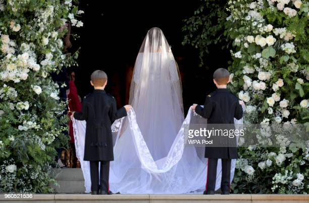 Ms Meghan Markle and her pageboys Brian Mulroney and John Mulroney arrive at her wedding to Prince Harry at St George's Chapel at Windsor Castle on...