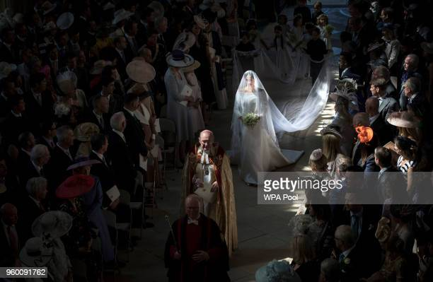 Ms Meghan Markle walks down the aisle at the start of her wedding to Prince Harry in St George's Chapel at Windsor Castle on May 19 2018 in Windsor...