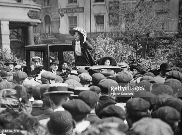 Ms Pankhurst addresses a mainly male crowd near the soldiers memorial during a Central hall byelection in London Ca 1910