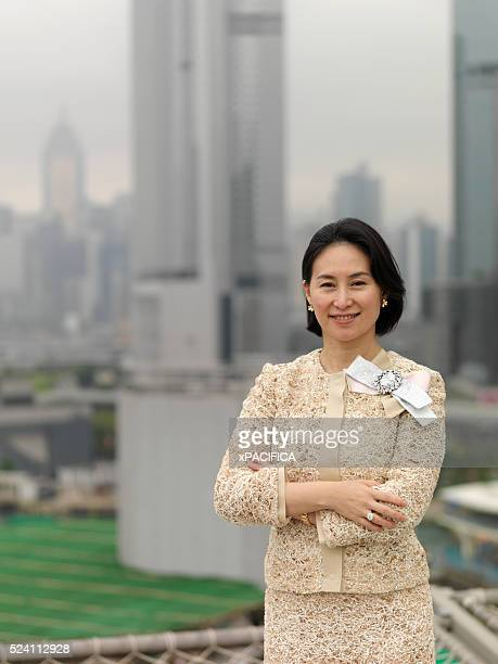 Ms Pansy Ho gaming magnate property tycoon budding airline mogul and upandcoming heir apparent to ageing father Stanley Ho's multibilliondollar...