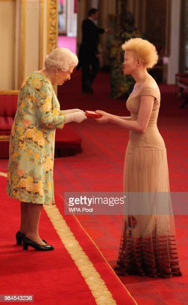 Ms Siposetu Sethu Mbuli from South Africa receives her Young Leaders Award from Queen Elizabeth II during the Queen's Young Leaders Awards Ceremony...