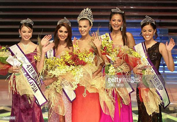 Ms Tatayana Nikitina 23 Russia waves to the crowd after winning the title of Miss AsiaPacific 2003 in Manila 26 October 2003 Other winners are 4th...