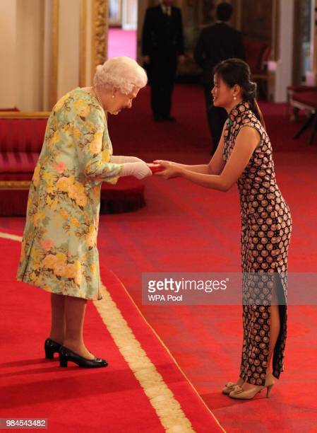 Ms Wen Shin Chia from Malaysia receives her Young Leaders Award from Queen Elizabeth II during the Queen's Young Leaders Awards Ceremony at...