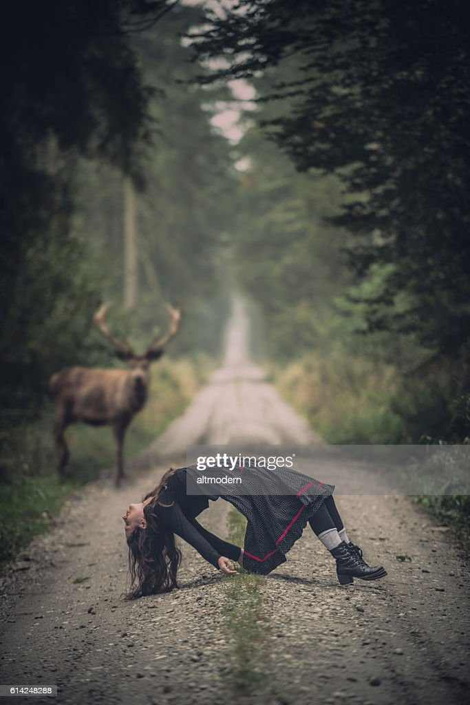 msystic scene with a women and a deer in forest : Stock Photo
