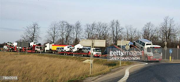 Trucks carry secondhand vehicles 18 January 2007 on a road near Mszczonow central Poland The European Court of Justice in Luxembourg ruled 16 January...