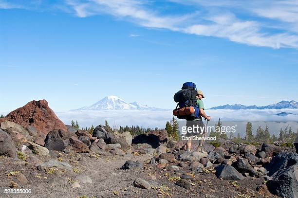 mt. adams wilderness, washington state, usa; hiker walking through avalanche valley camp - dan sherwood photography stock pictures, royalty-free photos & images