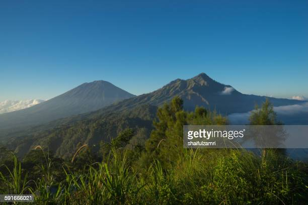 mt. agung & mt. abang - shaifulzamri stock pictures, royalty-free photos & images