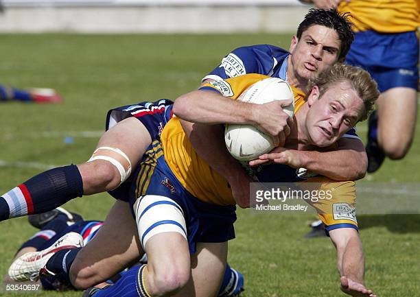 Mt Albert's Kevin Wright dives over for a try in the tackle of Otahuhu's Paul Atkon during the Bartercard Cup preliminary final rugby league match at...