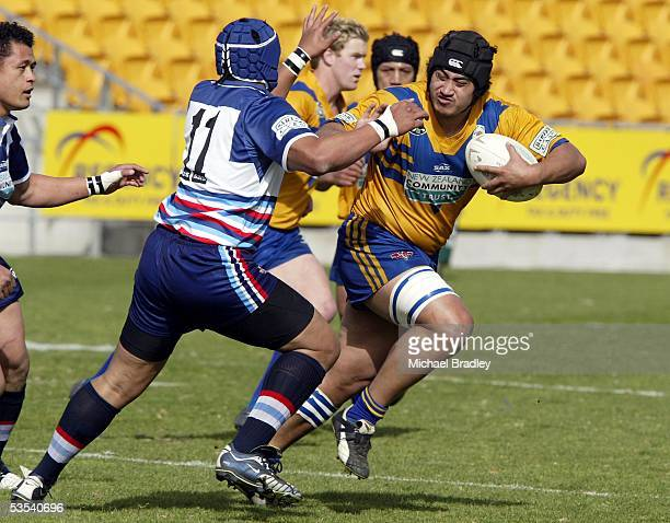 Mt Albert's Mathew Asaou looks to fend off Otahuhu's Slalii Tufeao during the Bartercard Cup preliminary final rugby league match at Ericsson Stadium...
