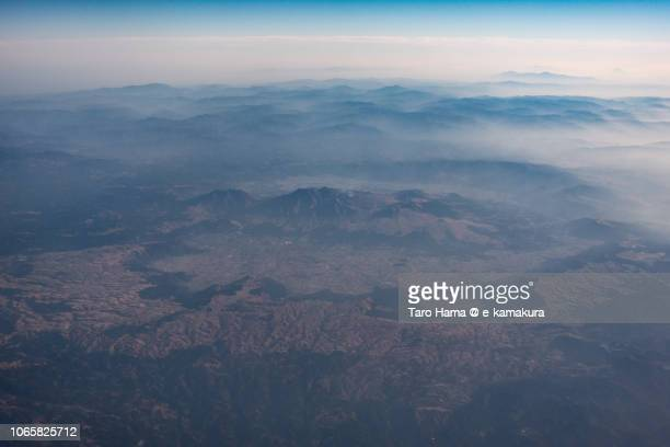 Mt. Aso in Kumamoto prefecture in Japan sunset time aerial view from airplane