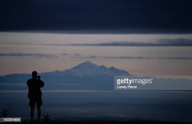 mt baker in washington, usa, from grouse mountain. - grouse mountain stock photos and pictures