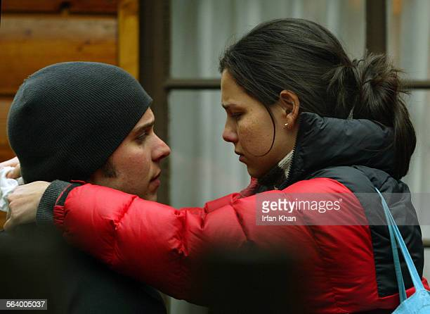 Mt Baldy Feb07 2005 – – Clay Senechal who was reported missing while hiking in Mt Baldy is hugged by teary Misti Traya Senechal and Jonathan Lemkin...
