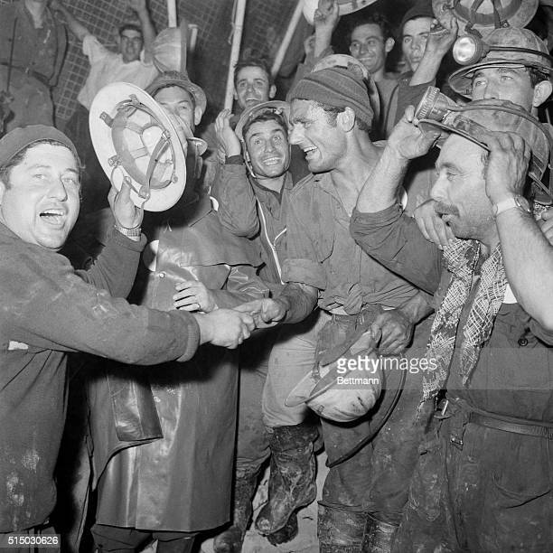 Mt Blanc HauteSavoie France French and Italian workers joyfully welcome one another after the final blastthrough of a tunnel under Mt Blanc between...