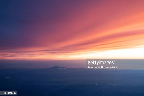 mt. chokai and sea of japan in japan sunset time aerial view from airplane - 日没 ストックフォトと画像