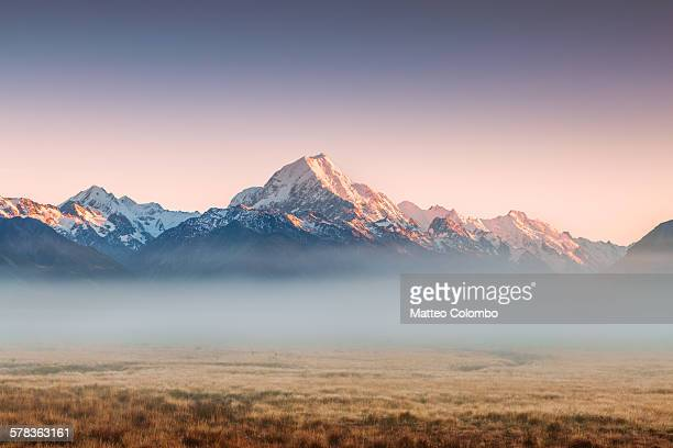 mt cook emerging from mist at dawn, new zealand - mountain range stock pictures, royalty-free photos & images