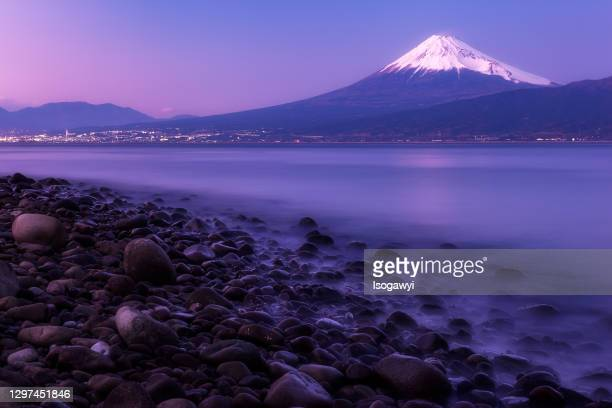 mt. fuji across the sea at twilight - isogawyi stock pictures, royalty-free photos & images