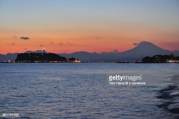 Mt. Fuji and Enoshima Island in Fujisawa city in Kanagawa prefecture in Japan, after sunset