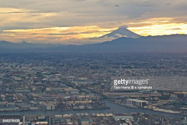 Mt. Fuji and factory area in Kawasaki city in Kanagawa prefecture sunset time aerial view from airplane