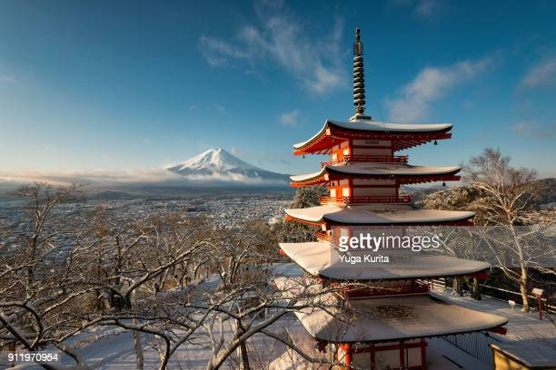 mt. fuji and pagoda in snow - fuji hakone izu national park stock photos and pictures