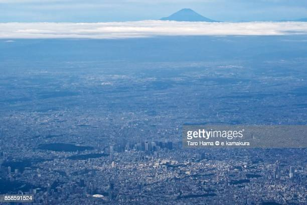 Mt. Fuji and Shinjuku District in Tokyo city in Japan daytime aerial view from airplane
