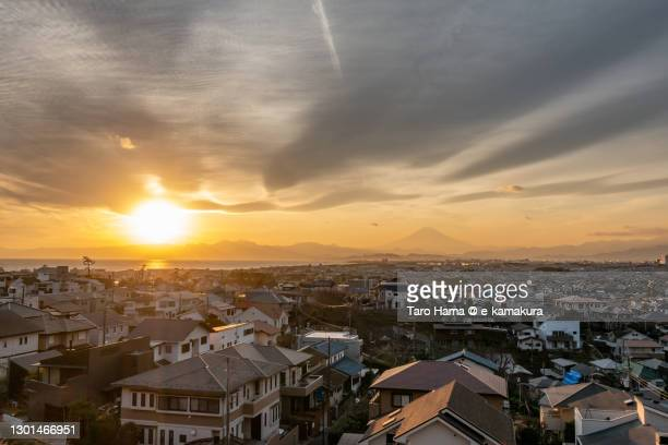 mt. fuji and the residential district by the beach in kanagawa prefecture of japan - 平塚市 ストックフォトと画像