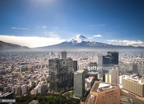 mt. fuji and tokyo cityscape - mount fuji stock photos and pictures