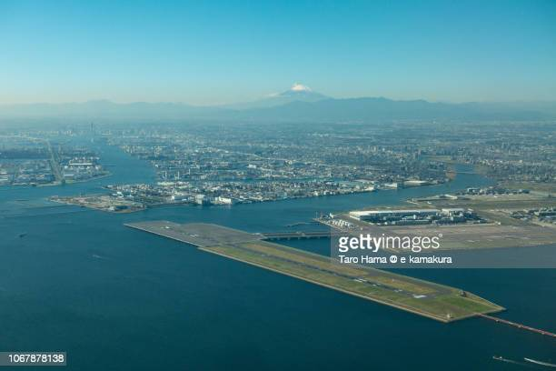 Mt. Fuji and Tokyo Haneda International Airport daytime aerial view from airplane