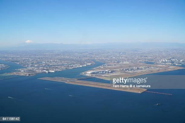 Mt. Fuji and Tokyo Haneda International Airport daytime aerial view from airplane