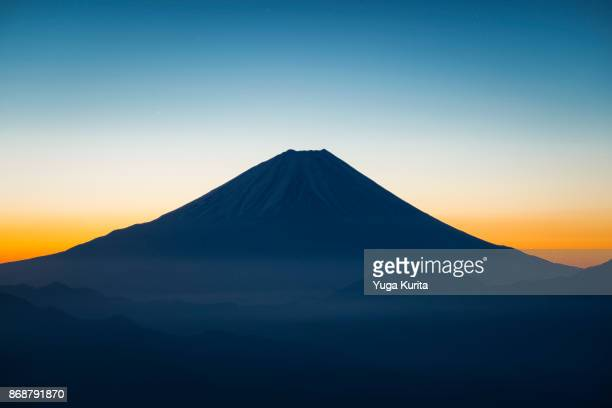 mt. fuji from mt. kushigata - mount fuji stock photos and pictures