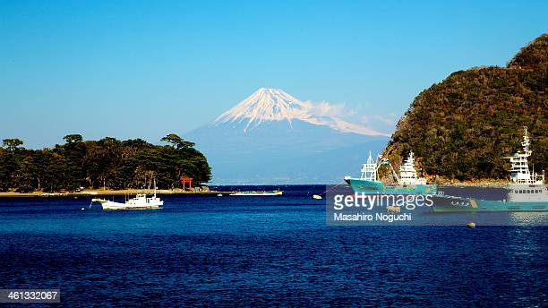 mt. fuji from the port of heda - shizuoka stock photos and pictures