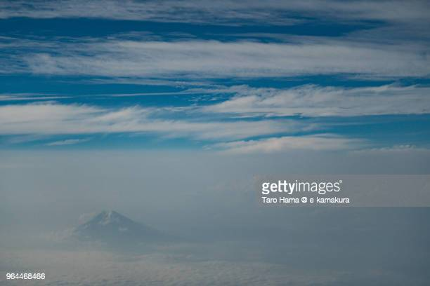 Mt. Fuji in clouds daytime aerial view from airplane