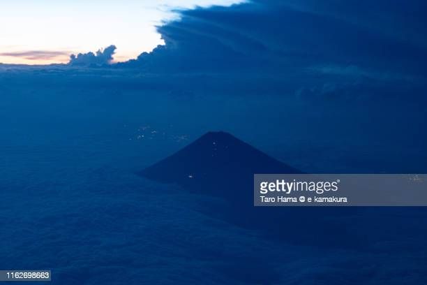 mt. fuji in japan, night time aerial view from airplane - mishima city stock photos and pictures