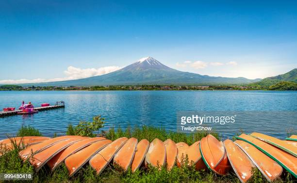 Mt. Fuji Japan volcano mountain at summer day with blue sky with boat