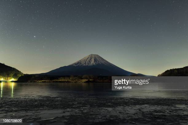 Mt. Fuji over a Frozen Lake at Night