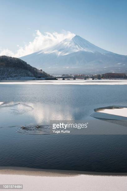Mt. Fuji over a Half-Frozen Lake after the Snow