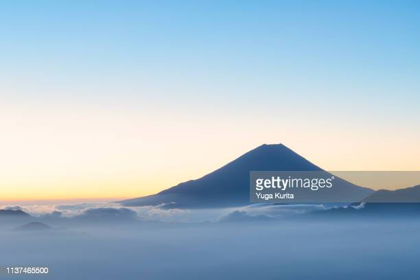 mt. fuji over a sea of clouds in the morning - 朝日 ストックフォトと画像