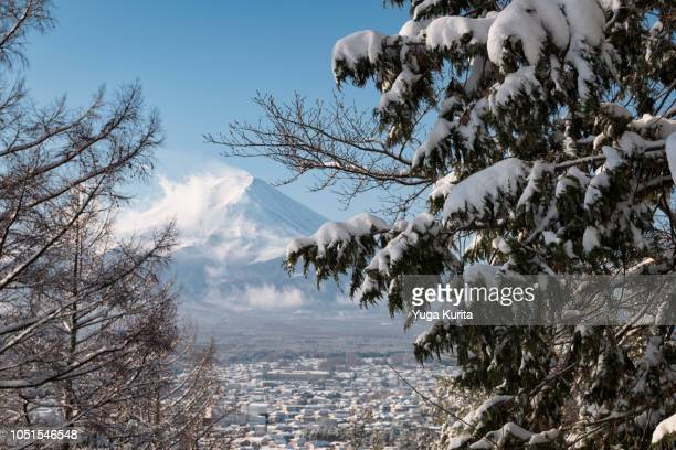 Mt. Fuji over a Snowy Town
