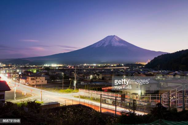 Mt. Fuji over Light Trails on the Road