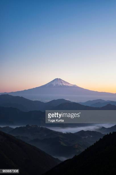 mt. fuji over the ground fogs and mountains - shizuoka stock photos and pictures