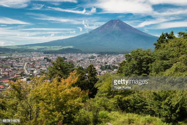 mt. fuji over the town of fujiyoshida in summer - yamanashi prefecture stock pictures, royalty-free photos & images
