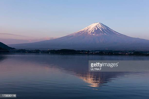 mt. fuji reflected in lake, kawaguchiko, - stratovolcano stock photos and pictures